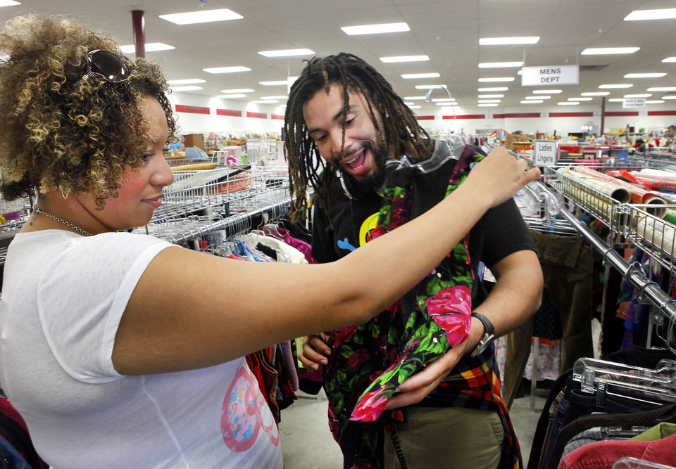 Photo - Siblings Brandy and Boe Clark shop at a thrift store, which is one of the things they like to do together. Brandy Clark has been through some hard times on her path to recovery with mental illness. Boe Clark has stood by her to support her. Photo by David McDaniel, The Oklahoma  David McDaniel