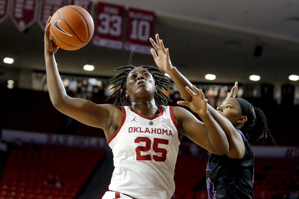 Photo - Oklahoma's Madi Williams (25) goes past Central Arkansas' Alana Canady (22) during an NCAA women's basketball game between the University of Oklahoma (OU) and Central Arkansas at Loyd Noble Center in Norman, Okla., Wednesday, Dec. 5, 2018. Photo by Bryan Terry, The Oklahoman