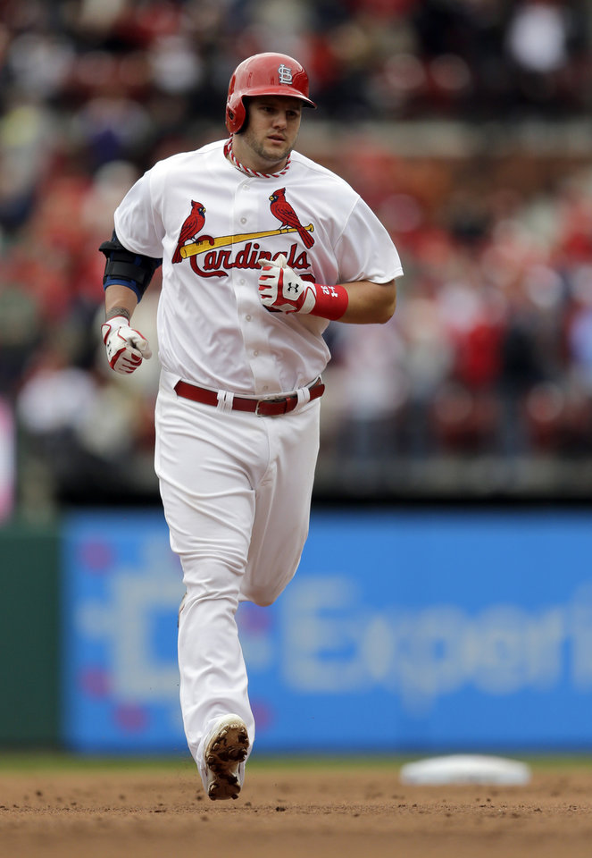 Photo - St. Louis Cardinals' Matt Adams rounds the bases after hitting a three-run home run during the third inning of a baseball game against the Milwaukee Brewers Wednesday, April 30, 2014, in St. Louis. (AP Photo/Jeff Roberson)