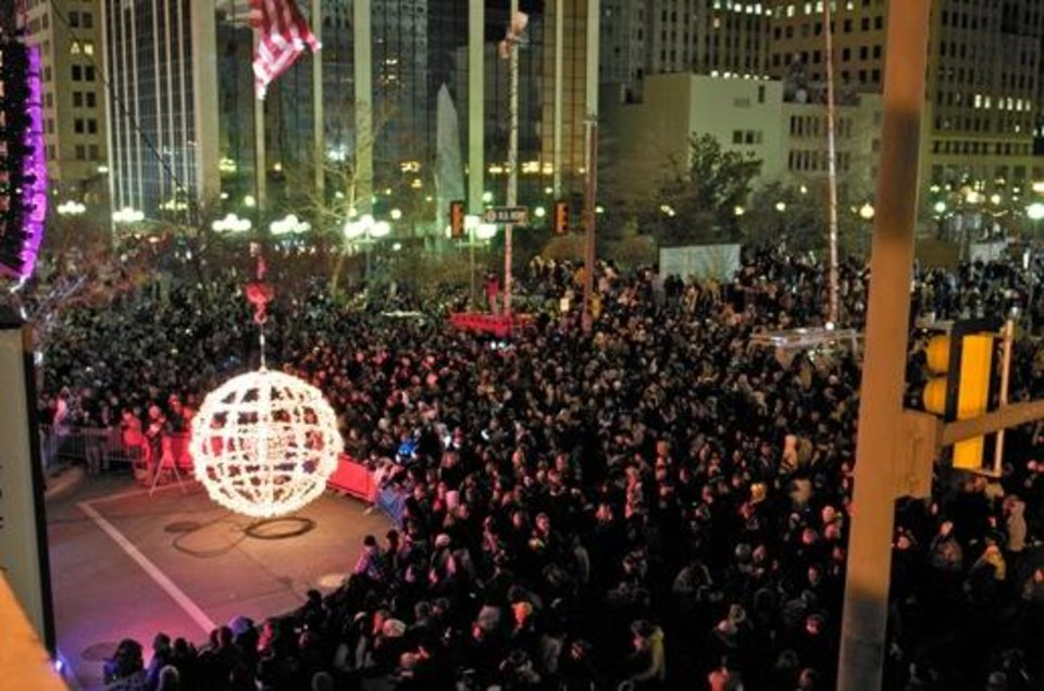 Photo -  A crowd waits for the giant lighted ball to ascend to mark the start of a new year at a past Opening Night New Year's Eve celebration in downtown Oklahoma City. An estimated 70,000 people attended the grand finale of last year's Opening Night.