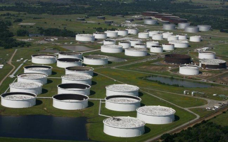 Photo -  A petroleum storage tank farm is shown in Cushing, one of the largest crude oil marketing hubs in the United States. SemGroup's Cushing terminal includes 7.6 million barrels of crude oil storage and is part of the planned merger with Energy Transder. SemGroup's tanks are some of the newest in Cushing, the company says. [Tulsa World]