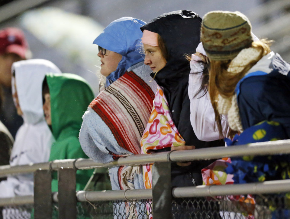 Casady fans are bundled up as they watch the game in the cold during a high school football game between Casady and Fort Worth All Saints Episcopal at Casady School in Oklahoma City, Friday, Oct. 18, 2013. Photo by Nate Billings, The Oklahoman