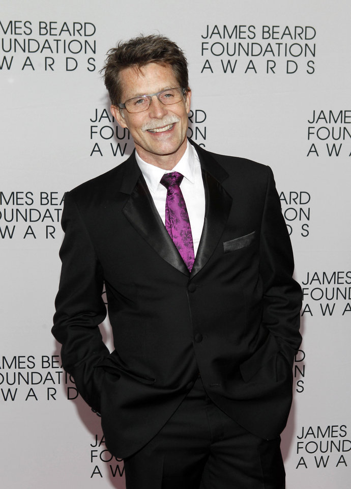 Photo -   Chef Rick Bayless arrives for the James Beard Foundation Awards, Monday, May 7, 2012, in New York. (AP Photo/Jason DeCrow)