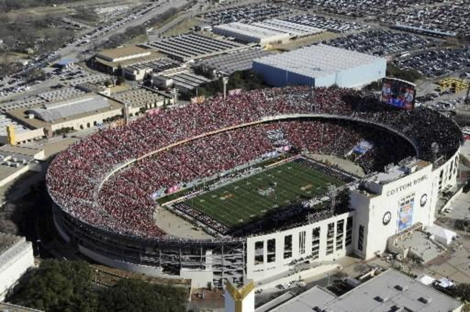 Photo - In this handout photo proved by the Cotton Bowl Athletic Association, fans fill the Cotton Bowl  Stadium in Dallas to watch Texas Tech play Mississippi in the 73rd Cotton Bowl NCAA college football game, on Friday, Jan. 2, 2009 in Dallas. This marks the final game in the bowl's namesake  stadium. (AP Photo/Cotton Bowl Athletic Association/Ian Halperin)