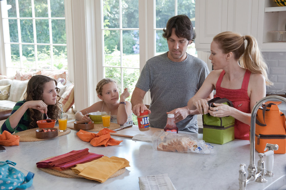 Photo - This publicity film image released by Universal Pictures shows, from left, Maude Apatow, Iris Apatow, Paul Rudd and Leslie Mann in a scene from the film,