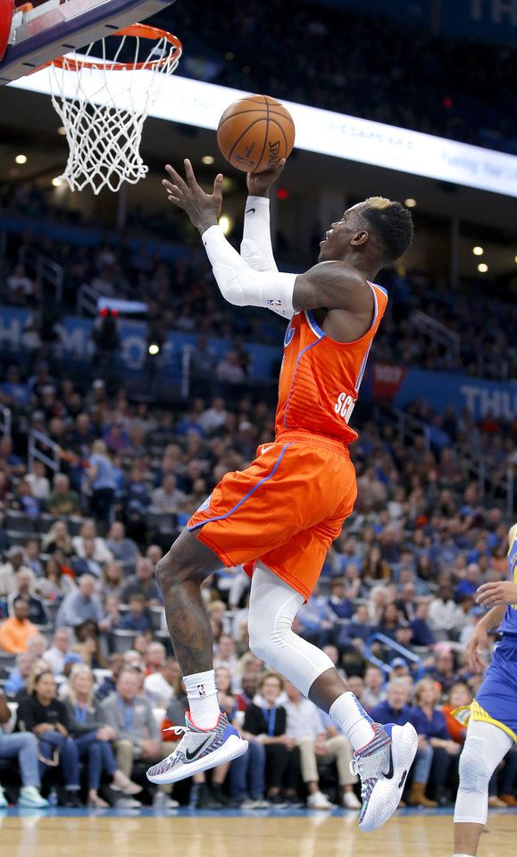 Photo - Oklahoma City's Dennis Schroder (17) goes up for a lay up during the NBA game between the Oklahoma City Thunder and Golden State Warriors at Chesapeake Energy Arena,  Sunday, Oct. 27, 2019. Thunder won 120-92.[Sarah Phipps/The Oklahoman]