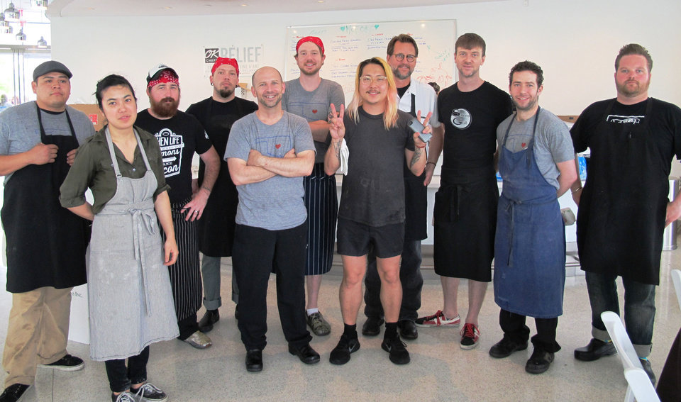 Photo - Chefs, from left, Sonny Fields, Ameilia Telc, Josh Valentine, Bucky Ward, Marc Dunham, Jonathon Stranger, Danny Bowien, Kurt Fleischfresser, Joseph Royer, Chris Becker and Russ Johnson gathered Monday for a second day of fundraising for the Oklahoma Chapter of the American Red Cross. Photo by Dave Cathey, The Oklahoman  DAVE CATHEY - THE OKLAHOMAN