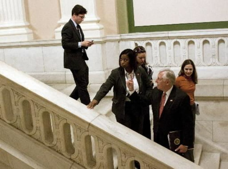 House Majority Leader  Steny  Hoyer, D-Md., gestures to reporters as he leaves a Democratic Caucus on Capitol Hill in Washington, Monday, March 15, 2010.(AP Photo/Harry Hamburg)