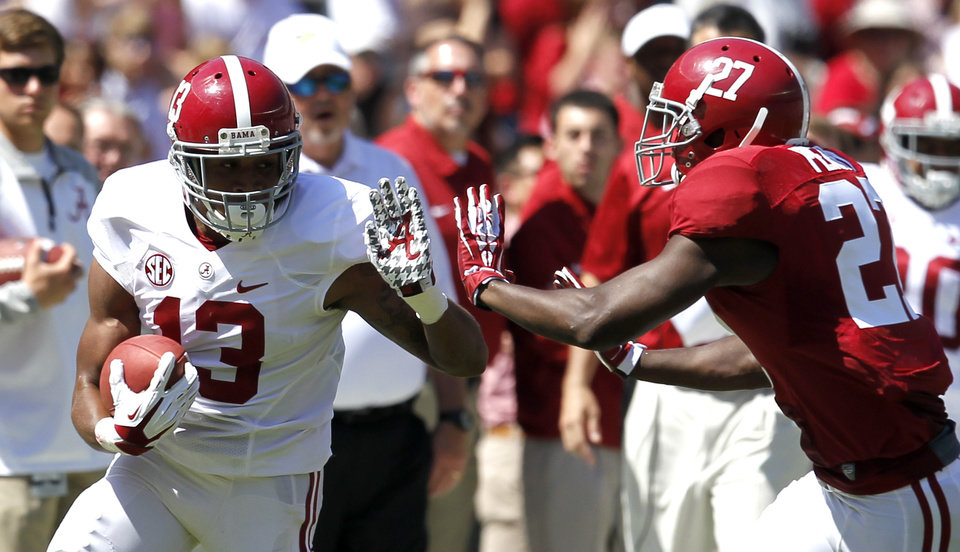 Photo - Wide receiver ArDarius Stewart (13) is pushed out of bounds by defensive back Nick Perry (27) after a a reception for a first down during Alabama's A-Day NCAA college football spring game Saturday, April 19, 2014, in Tuscaloosa, Ala. (AP Photo/Butch Dill)