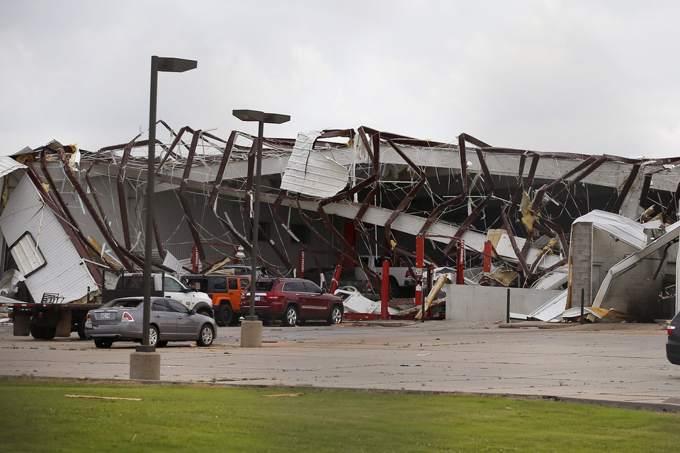 Photo - Tornado damage to a car dealership along State Highway 81 in El Reno, Okla., Sunday, May 26, 2019. [Bryan Terry/The Oklahoman]