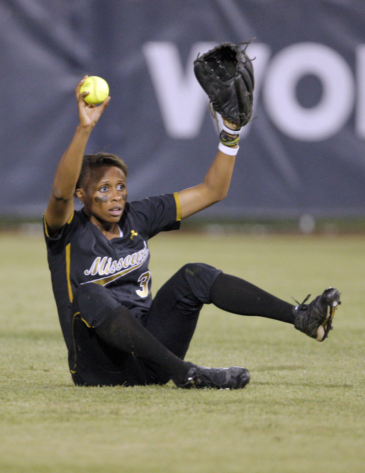 Photo - Missouri's Rhea Taylor (3) reacts after catching a fly ball during the Women's College World Series game between Baylor and Missouri at the ASA Hall of Fame Stadium in Oklahoma City, Saturday, June 4, 2011. Photo by Sarah Phipps, The Oklahoman