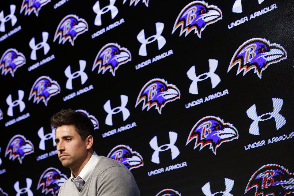 Photo - Baltimore Ravens tight end Dennis Pitta discusses his new five-year contract during an NFL football news conference, Wednesday, March 5, 2014, at the Ravens practice facility in Owings Mills, Md.  (AP Photo/Patrick Semansky)