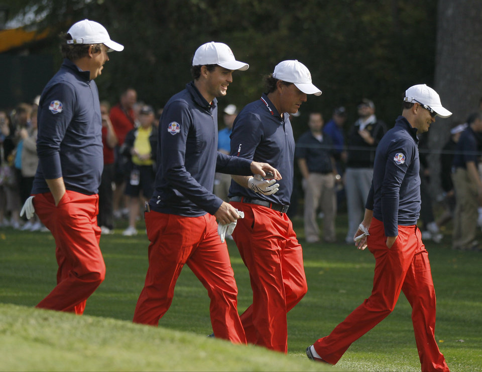 Photo -   USA's Jason Dufner, left to right, Keegan Bradley, Phil Mickelson and Zach Johnson make their way off the fifth tee during a practice round at the Ryder Cup PGA golf tournament Wednesday, Sept. 26, 2012, at the Medinah Country Club in Medinah, Ill. (AP Photo/Charles Rex Arbogast)