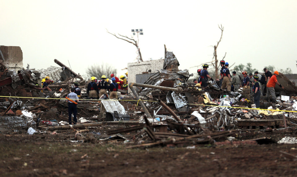 Rescuers search through debris at the Plaza Towers Elementary School in Moore following a deadly tornado, Monday, May 20, 2013. Photo by Sarah Phipps, The Oklahoman