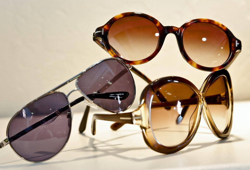 Photo - Classic aviators, retro round and oversize butterfly sunglasses, all by Tom Ford, at On a Whim. Photo by Chris Landsberger, The Oklahoman.   CHRIS LANDSBERGER