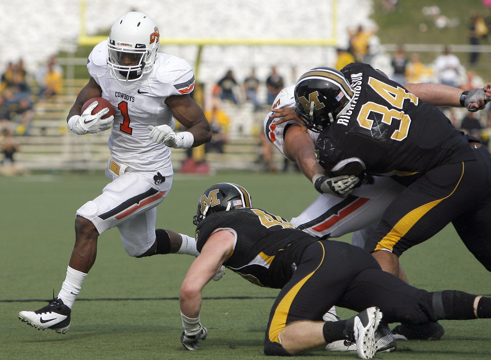 Photo - Oklahoma State's Joseph Randle (1) gets by the Missouri defense during a college football game between the Oklahoma State University Cowboys (OSU) and the University of Missouri Tigers (Mizzou) at Faurot Field in Columbia, Mo., Saturday, Oct. 22, 2011. Photo by Sarah Phipps, The Oklahoman