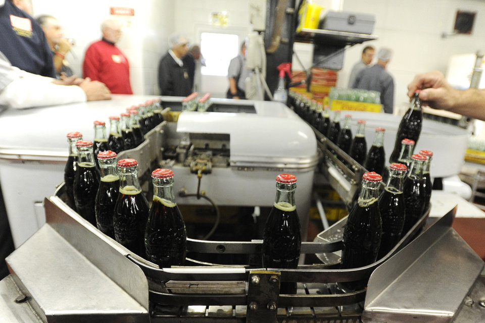 Photo -   FILE - In this Tuesday, Oct. 9, 2012, photo, bottles in the last run are prepared for crates at the Coca-Cola Bottling Company in Winona, Minn. Nearly 6,000 6.5-ounce returnable glass bottles were filled for the last time after 80 years of production. (AP Photo/Winona Daily News, Andrew Link)