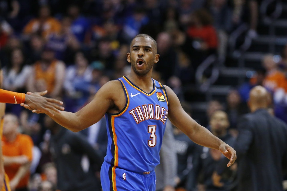Photo - Oklahoma City Thunder guard Chris Paul shouts after making a basket against the Phoenix Suns during the second half of an NBA basketball game Friday, Jan. 31, 2020, in Phoenix. The Thunder won 111-107. (AP Photo/Ross D. Franklin)