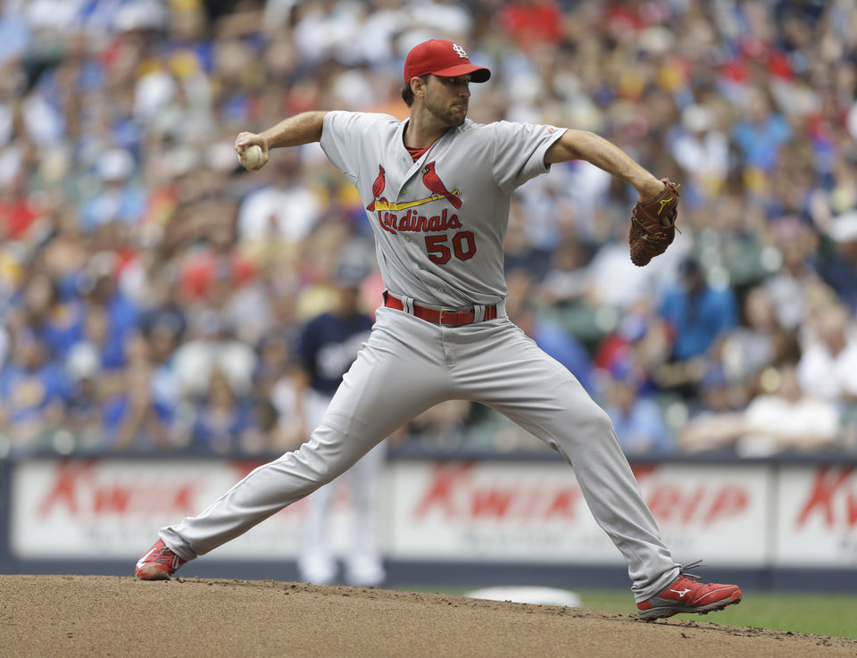 Photo - St. Louis Cardinals starting pitcher Adam Wainwright throws to the Milwaukee Brewers during the first inning of a baseball game Saturday, July 12, 2014, in Milwaukee. (AP Photo/Jeffrey Phelps)