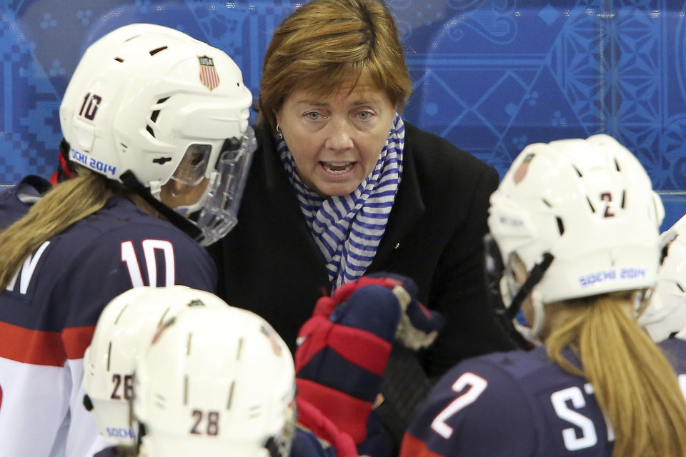 Photo - USA head coach Katey Stone talks to the team during a break in the action at the 2014 Winter Olympics women's ice hockey game between Canada and the United States at Shayba Arena, Wednesday, Feb. 12, 2014, in Sochi, Russia. (AP Photo/J. David Ake)