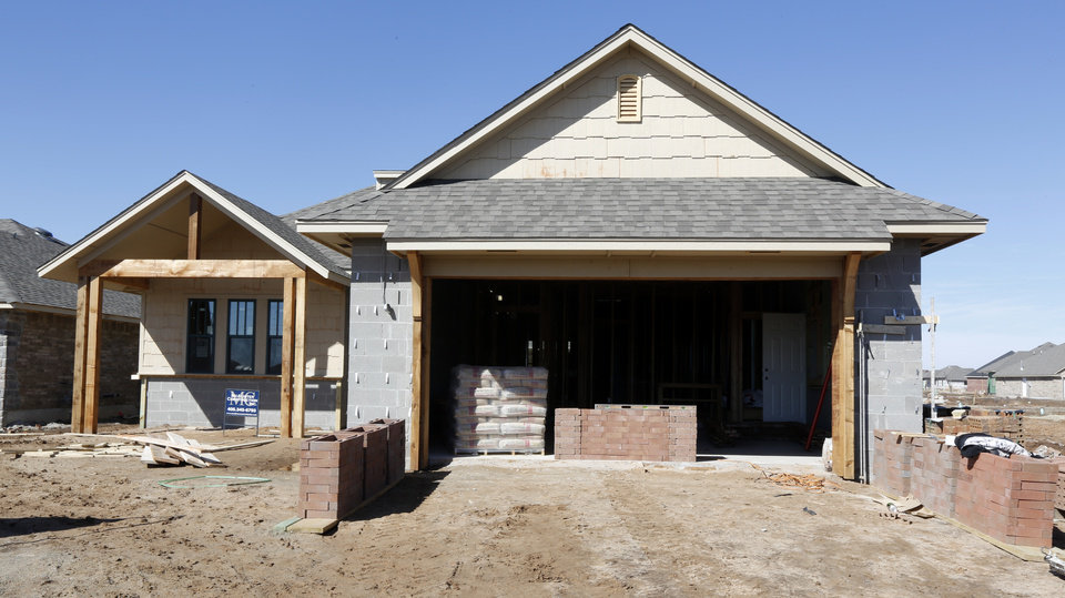 Photo - Josh Kitchen, a partner in McAlister Construction, says the storm-resistant house the company is building at 14517 S Brent Drive is unusual in its use of 8-inch Dolese concrete block walls.  Steve Gooch -