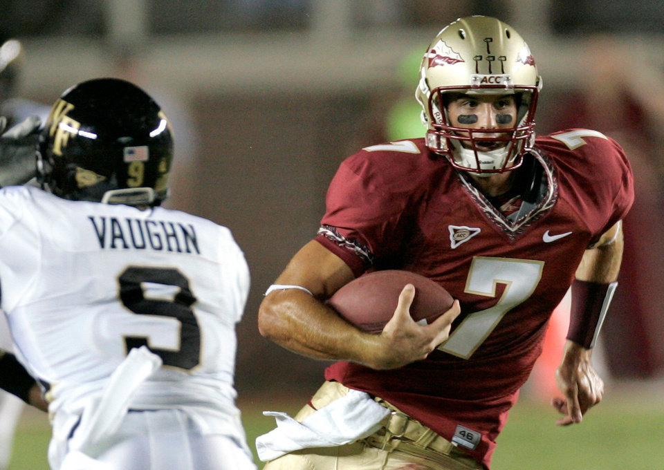 Photo - Florida State University quarterback Christian Ponder, right, runs fas Wake Forest University defender Chip Vaughn moves in to make the tackle during the second quarter of an NCAA college football game, Saturday, Sept. 20, 2008, in Tallahassee, Fla.(AP Photo/Phil Coale) ORG XMIT: FLPC210