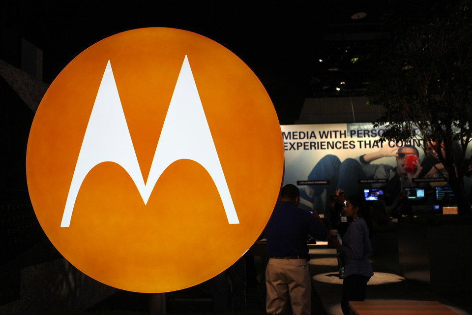 Photo - FILE - This file photo made Jan. 9, 2010, shows the Motorola logo at the company's exhibit at the Consumer Electronics Show in Las Vegas. Zebra Technologies will spend more than $3 billion to buy the enterprise business of Motorola Solutions in a considerable expansion that is both technological and geographical. Motorola's enterprise business makes hand-held bar code scanners and mobile and tablet computers, among other products. (AP Photo/Paul Sakuma, File)