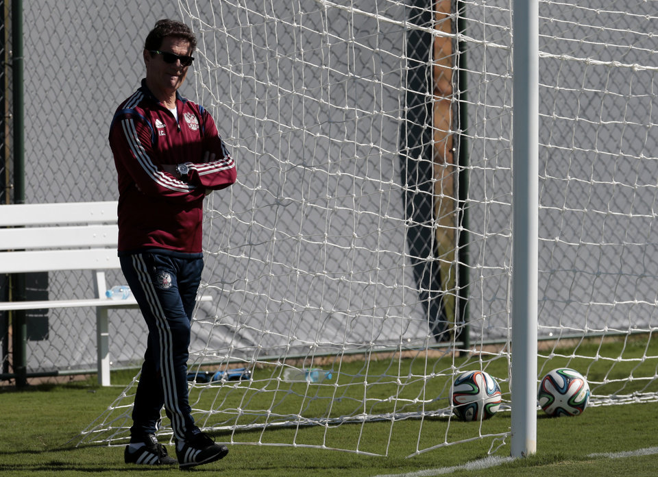 Photo - Fabio Capello, Italian head coach of Russian national soccer team walks during a training session in Itu, Brazil, on Wednesday, June 11, 2014. Russia will play in group H of the 2014 soccer World Cup. (AP Photo/Ivan Sekretarev)