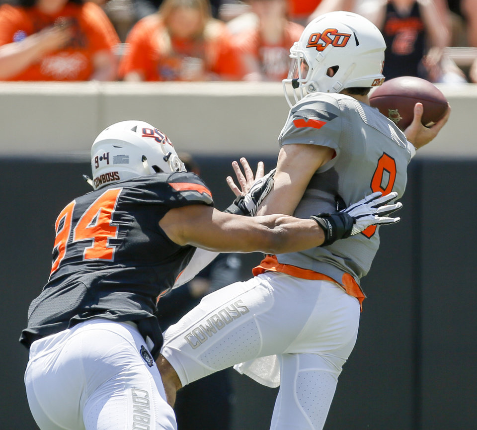 Photo - Jordan Brailford (94) pressures quarterback John Kolar (9) during the spring football game for the Oklahoma State Cowboys (OSU) at Boone Pickens Stadium in Stillwater, Okla., Saturday, April 28, 2018. Photo by Nate Billings, The Oklahoman