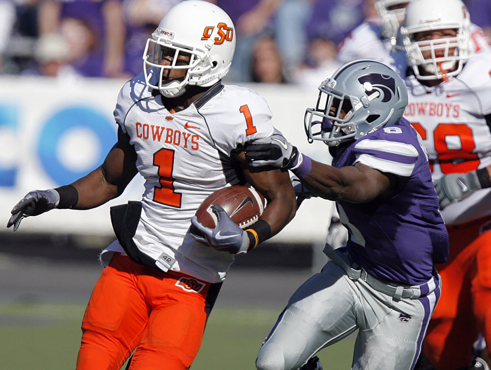 Photo - Oklahoma State's Joseph Randle (1) gets past Kansas State's Stephen Harrison (8) during the first half of the college football game between the Oklahoma State University Cowboys (OSU) and the Kansas State University Wildcats (KSU) on Saturday, Oct. 30, 2010, in Manhattan, Kan.   Photo by Chris Landsberger, The Oklahoman