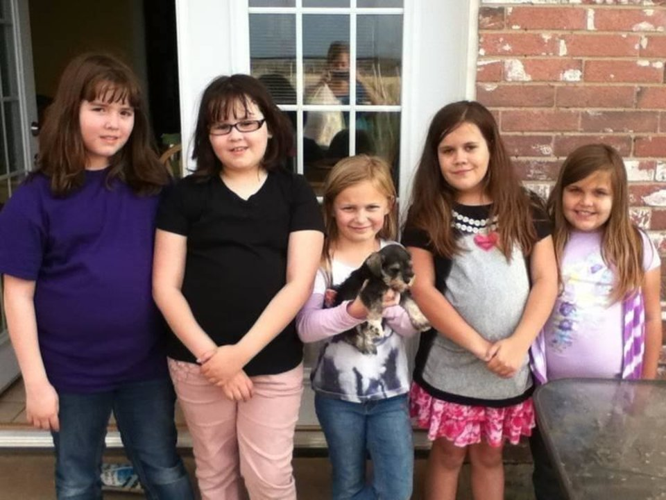 Photo - From left to right: sisters Trinity and Antonia Candelaria; an unidentified neighborhood friend; and Emily and Luci Conatzer. Antonia Candelaria and Emily Conatzer died May 20 at Plaza Towers Elementary School after sheltering in a hallway. Photo provided