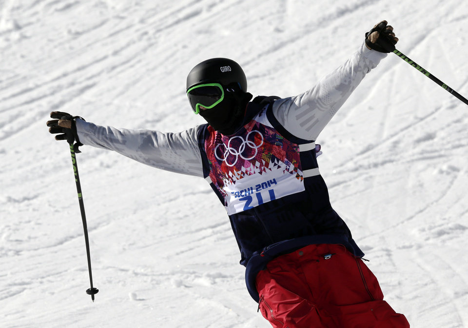 Photo - Men's ski slopestyle gold medal winner Joss Christensen of the United States celebrates  at the end of his last run, at the Rosa Khutor Extreme Park,  at the 2014 Winter Olympics, Thursday, Feb. 13, 2014, in Krasnaya Polyana, Russia. (AP Photo/Andy Wong)