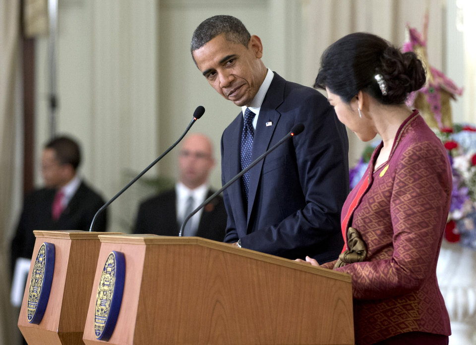 U.S. President Barack Obama, center, and Thai Prime Minister Yingluck Shinawatra acknowledge each other at a joint news conference at the Government House in Bangkok, Thailand, Sunday, Nov. 18, 2012. (AP Photo/Carolyn Kaster)
