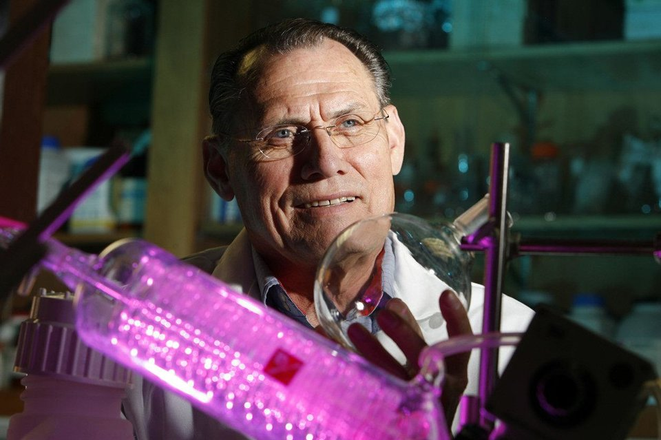 Photo - OMRF researcher Dr. Robert Floyd, working with Dr. Rheal Towner, has developed a compound that attacks cancer cells on multiple fronts, according to a new paper. PHOTO PROVIDED.