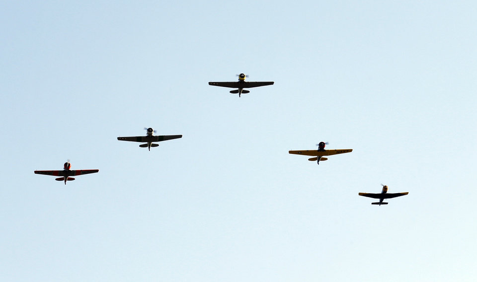 Photo - The Warbirds airplane group perform before the college football game where the University of Oklahoma Sooners (OU) play the University of Louisiana Monroe Warhawks at Gaylord Family-Oklahoma Memorial Stadium in Norman, Okla., on Saturday, Aug. 31, 2013. Photo by Steve Sisney, The Oklahoman