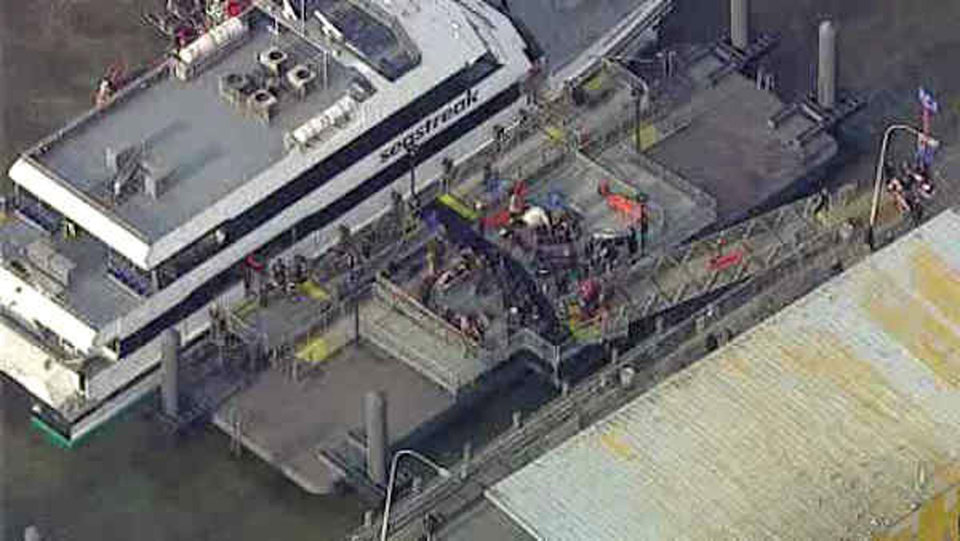 Photo - ADDS NUMBER OF PEOPLE INJURED- This aerial photo provided by WABC News Channel 7 shows emergency personnel at the scene of a ferry crash in Lower Manhattan, Wednesday, Jan. 9, 2013, in New York. The Fire Department says at least 50 people were injured when a ferry from New Jersey struck a dock during rush hour. (AP Photo/WABC News Channel 7)