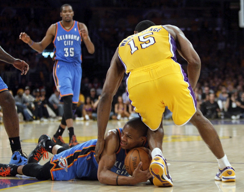 Photo - LOS ANGELES LAKERS: Oklahoma City's Russell Westbrook (0) and Los Angeles' Metta World Peace (15) fight for the ball before a scrum and double technicals in the second quarter during Game 3 in the second round of the NBA basketball playoffs between the L.A. Lakers and the Oklahoma City Thunder at the Staples Center in Los Angeles, Friday, May 18, 2012. Photo by Nate Billings, The Oklahoman
