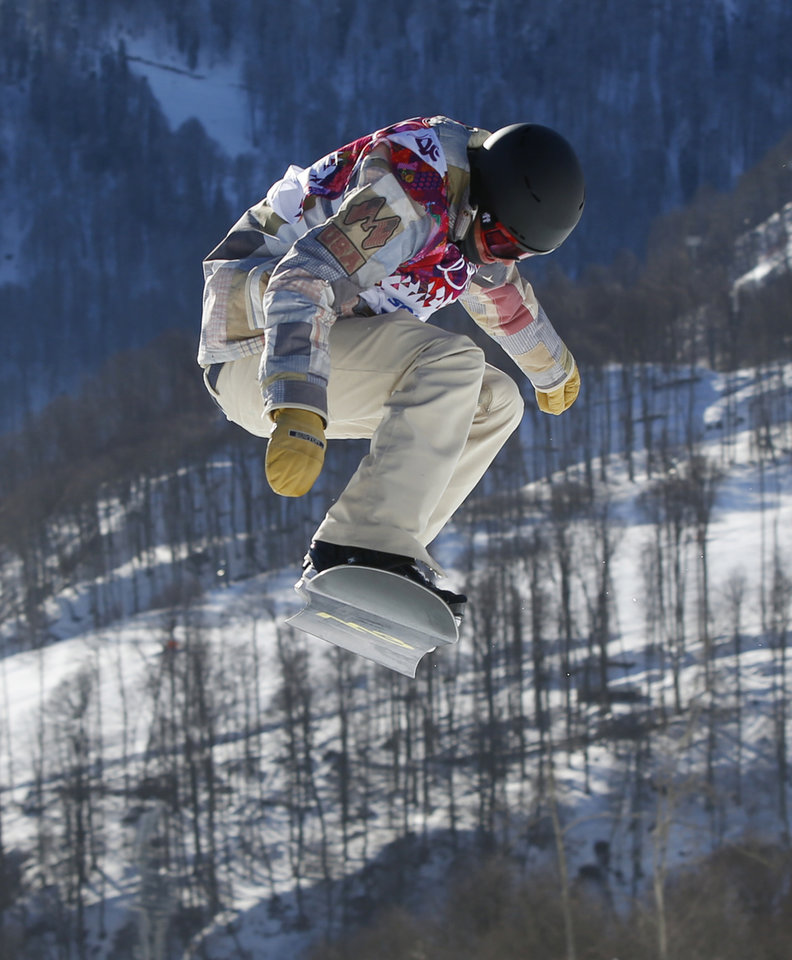 Photo - United States' Charles Guldemond takes a jump during men's snowboard slopestyle qualifying at the Rosa Khutor Extreme Park ahead of the 2014 Winter Olympics, Thursday, Feb. 6, 2014, in Krasnaya Polyana, Russia. (AP Photo/Sergei Grits)