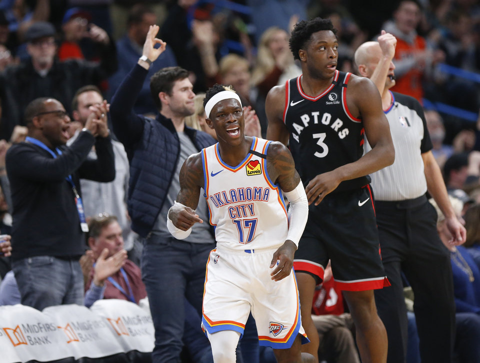 Photo - Oklahoma City's Dennis Schroder (17) reacts in front of Toronto's OG Anunoby (3) after making a jump shot in the third quarter during an NBA basketball between the Oklahoma City Thunder and the Toronto Raptors at Chesapeake Energy Arena in Oklahoma City, Wednesday, Jan. 15, 2020. Toronto won 130-121. [Nate Billings/The Oklahoman]