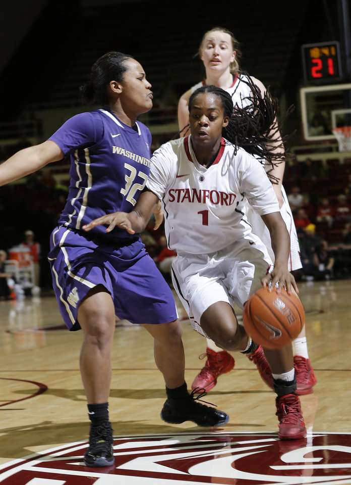 Photo - Stanford guard Lili Thompson (1) dribbles next to Washington guard Jazmine Davis (32) during the second half of an NCAA college basketball game on Thursday, Feb. 27, 2014, in Stanford, Calif. Stanford won 83-60. (AP Photo/Marcio Jose Sanchez)