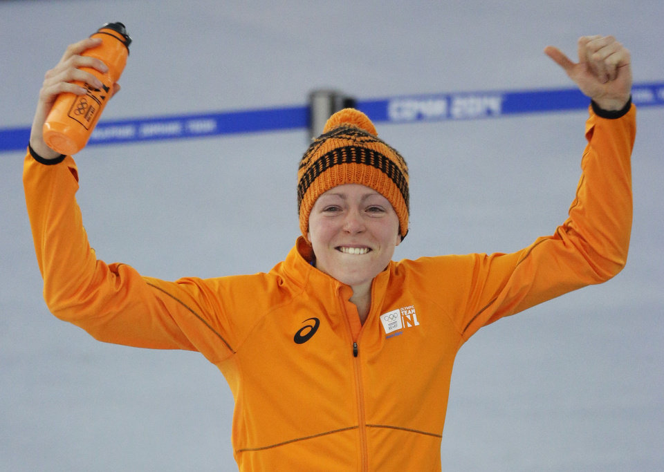Photo - Gold medallist Jorien ter Mors of the Netherlands celebrates after the women's 1,500-meter speedskating race at the Adler Arena Skating Center during the 2014 Winter Olympics in Sochi, Russia, Sunday, Feb. 16, 2014. (AP Photo/David J. Phillip )