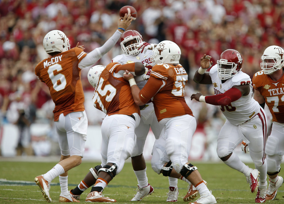Photo - UT's Case McCoy (6) throw a pass during the Red River Rivalry college football game between the University of Oklahoma Sooners and the University of Texas Longhorns at the Cotton Bowl Stadium in Dallas, Saturday, Oct. 12, 2013. Photo by Bryan Terry, The Oklahoman