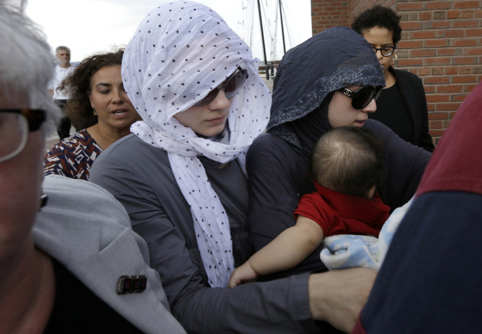 Photo - Tsarnaev family members and others depart the federal courthouse in Boston following the arraignment of Boston Marathon bombing suspect Dzhokhar Tsarnaev Wednesday, July 10, 2013, in Boston. The April 15 attack killed three and wounded more than 260. The 19-year-old Tsarnaev has been charged with using a weapon of mass destruction. (AP Photo/Steven Senne)