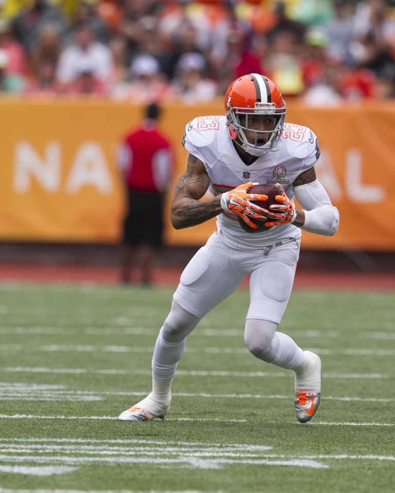 Photo - After stripping the ball from Philadelphia Eagles Desean Jackson (10), of Team Sanders, Cleveland Browns cornerback Joe Haden (23), of Team Rice, runs the ball down the field during the second quarter at the NFL Pro Bowl football game at Aloha Stadium, Sunday. Jan. 26, 2014, in Honolulu.  (AP Photo/Marco Garcia)
