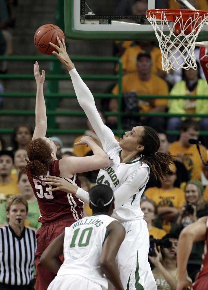 Photo - Baylor's Brittney Griner (42) blocks the shot of Oklahoma's Joanna McFarland (53) during the second half of an NCAA college basketball game Saturday, Jan. 26, 2013, in Waco Texas.  It was Griners' 665th career blocked shot, surpassing the NCAA women's record set by Louella Tomlinson for St. Mary's in California from 2007-11. Baylor won 82-65.  (AP Photo/LM Otero) ORG XMIT: TXMO105