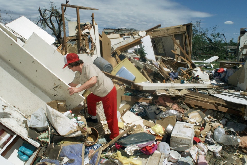 MAY 3, 1999 TORNADO: Tornado victims, damage: Dolores Harpole looks in her closet for items that she can save. 6121 SE 7th in Midwest City.