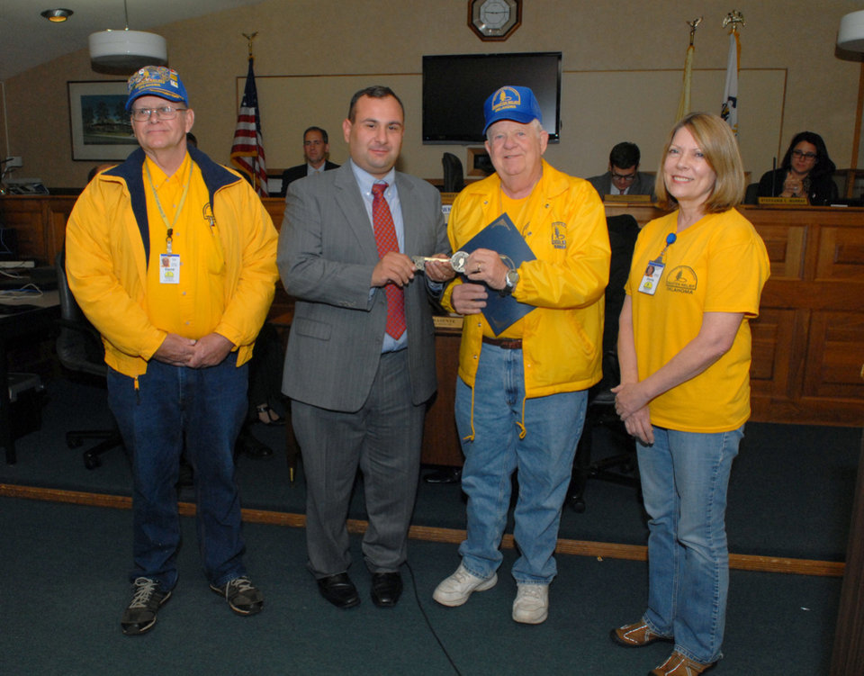 Oklahoma Baptist Disaster Relief team member David Johnson, left, and incident command administrator Doris Perryman look on as Middletown, N.J., Mayor Anthony P. Fiore, second from left, presents Dave Karr, another Oklahoma Baptist disaster relief leader, a key to the city.