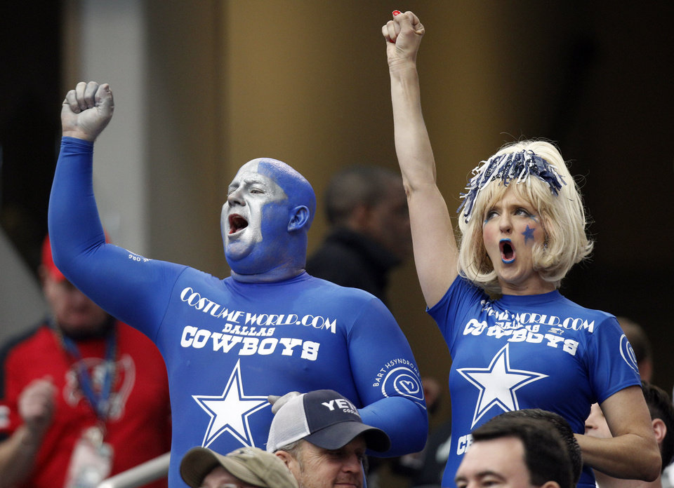 Photo - Dallas Cowboys fans cheer the team during the first half of an NFL football game against the Tampa Bay Buccaneers, Sunday, Sept. 23, 2012, in Arlington, Texas. (AP Photo/LM Otero)