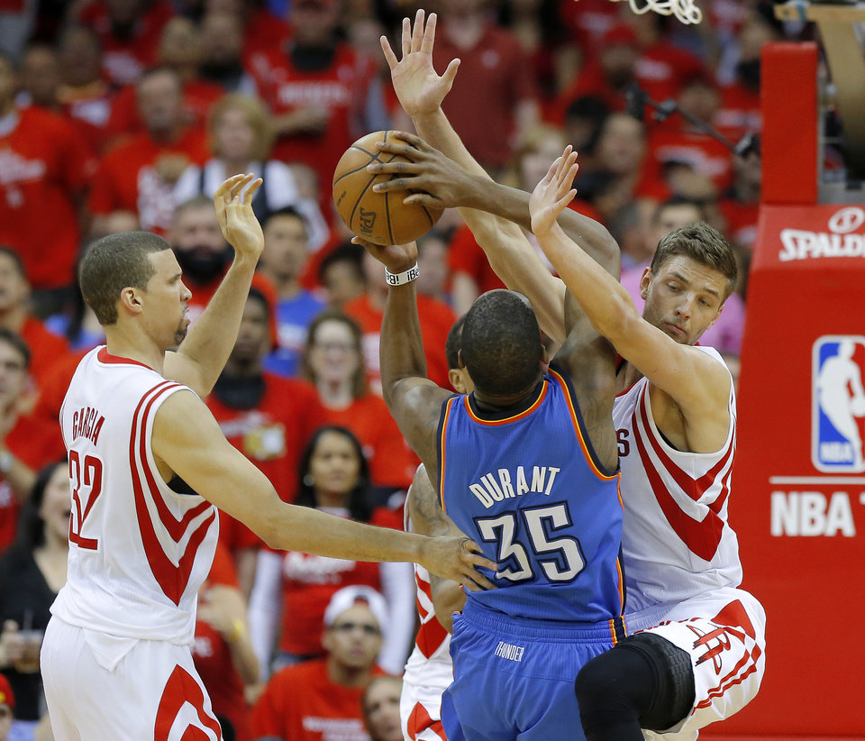 Photo - Oklahoma City's Kevin Durant (35) runs into Houston's Chandler Parsons (25) as Francisco Garcia (32) watches during Game 4 in the first round of the NBA playoffs between the Oklahoma City Thunder and the Houston Rockets at the Toyota Center in Houston, Texas,Sunday, April 29, 2013. Oklahoma City lost 105-103. Photo by Bryan Terry, The Oklahoman