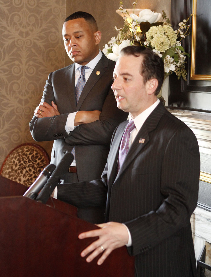 Photo - Republican National Committee Chairman Reince Priebus speaks to members of the press at the State Capitol in Oklahoma City, OK, Monday, May 13, 2013. Behind him is Oklahoma House Speaker T W Shannon.  By Paul Hellstern, The Oklahoman